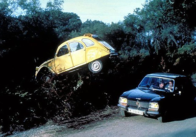 A Citroen 2CV in mid air