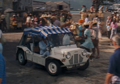 A Mini Moke in a busy market