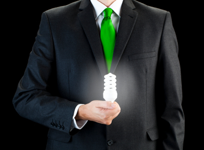 A bright lightbulb being held by a man with a green tie