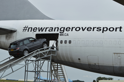 Range Rover going into an aeroplane