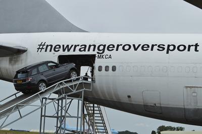 Range Rover going into an aeroplane