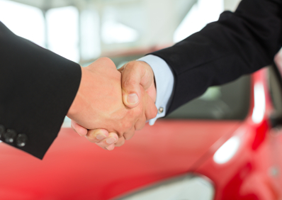 Car dealership handshake