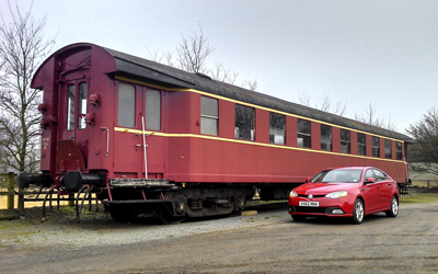 Image of MG6 next to train carriage