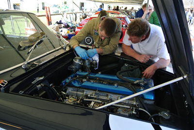 Image of people looking at an engine at 72mm show