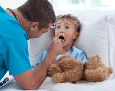 Image of kid being examined by doctor