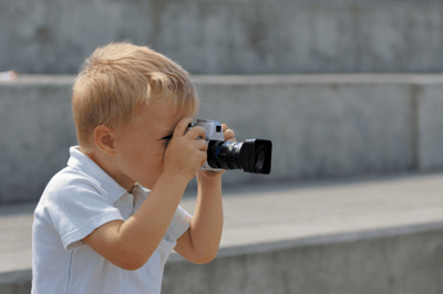 Image of child pointing camera
