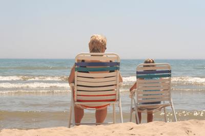 Image of grandparent and grandchild at beach