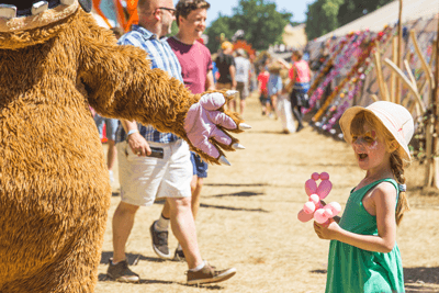 Image of kid at festival meeting the gruffalo