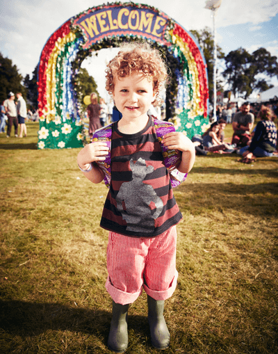 Image of kid having fun at Camp Bestival festival