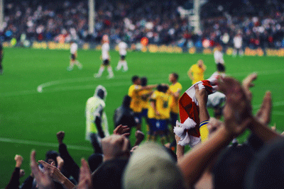 Image of Arsenal away fans celbrating