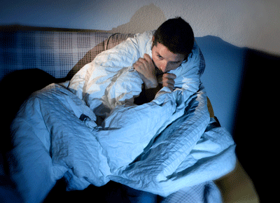 Image of man under duvet