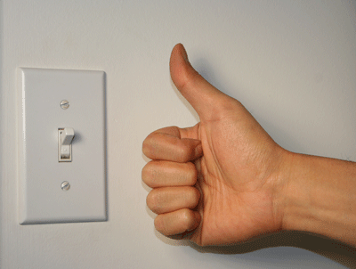 Image of a thumbs-up given to a power switch