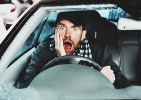 Image of shocked man in car