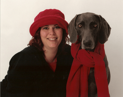 Owner and dog with festive scarf
