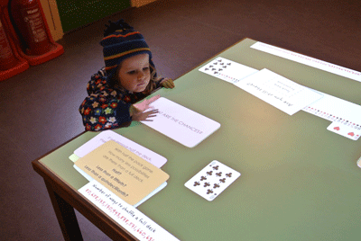 Image of child playing with interactive game