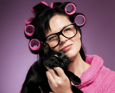 Woman with rollers and cat