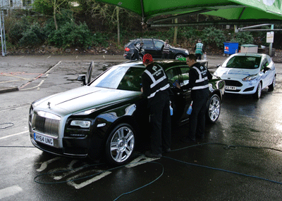 Image of the Rolls Royce Ghost being washed