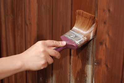 Image of a fence being painted