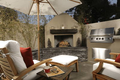 Image of an outdoor room with BBQ and log fire