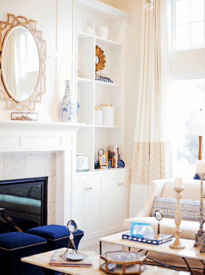 Image of a beautifully decorated living room with mirror on wall