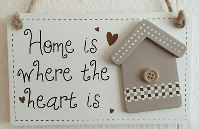 Image of a 'home is where the heart is' sign