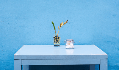 Image of a bright blue feature wall with matching table
