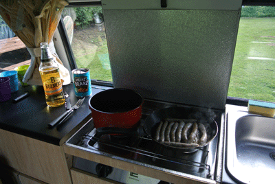 Image of bacon and sausages in a campervan