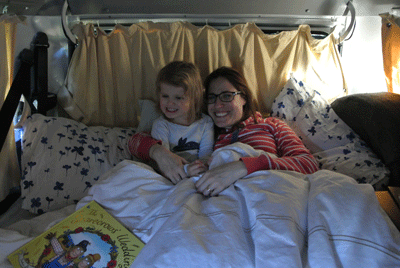 Image of mother and daughter inside campervan