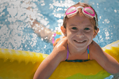 Image of a girl playing in a pool