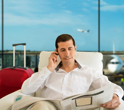 Image of a man enjoying the executive lounge of an airport