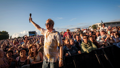 Image of Chris Evans hyping the crowd at CarFest