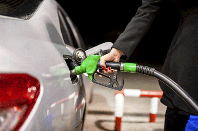 Image of a woman filling up a car