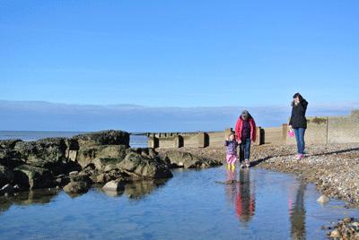 Image of family on beach in St Leonards