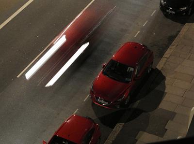 Image of Mazda on road at night