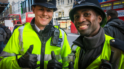 Image of two smiling policemen