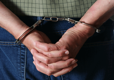 Image of hands in cuffs