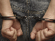 Image of hand in cuffs