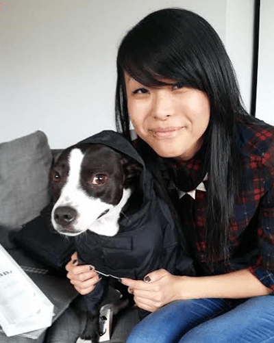 Image of Victoria Cao with her dog Archer.