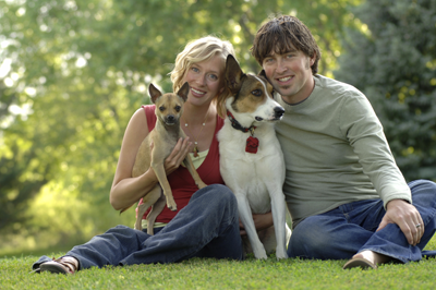 Image of a couple with dogs
