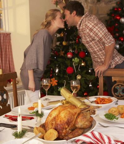 Image of couple smooching under miseltoe