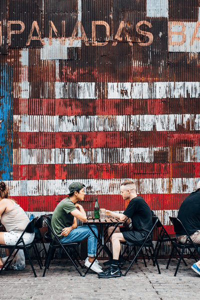 Image of two people eating at a hipster establishment in Williamsburg