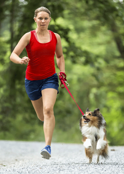 Image of a human and a dog running