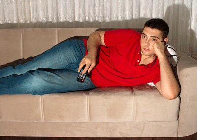 Image of man idling on sofa
