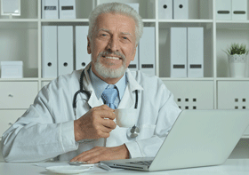 Image of avuncular doctor enjoying espresso