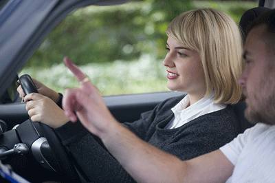Image of woman receiving driving instruction