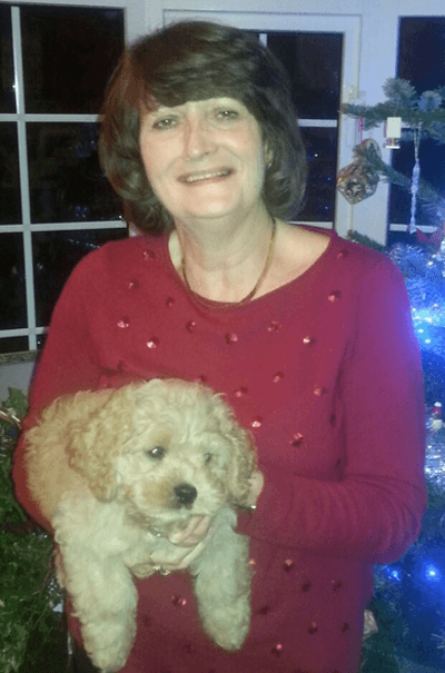Rorgy the cockapoo with his owner Jane