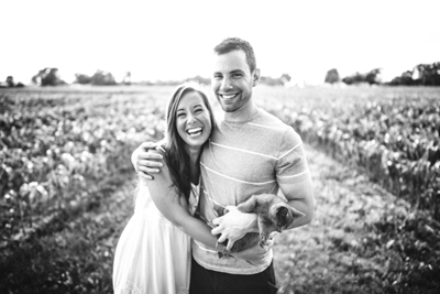 Image of a couple having fun in a field