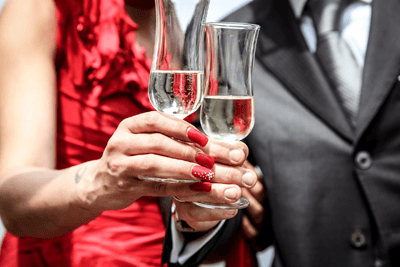 Image of a couple toasting with champagne