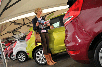 Image of woman looking at cars