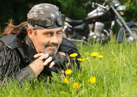 A motorcyclist enjoying some spring flowers